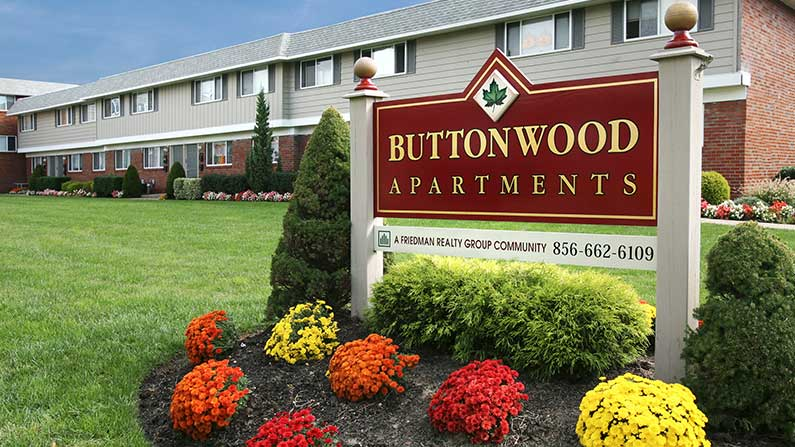 Entrance sign and garden at Buttonwood Apartments in Maple Shade, NJ