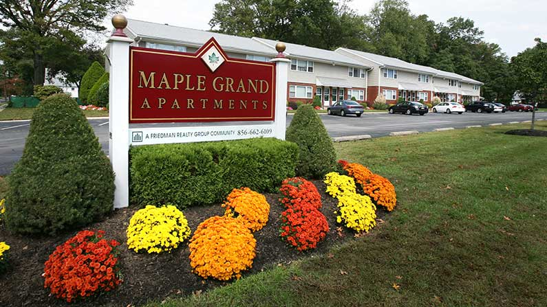 Maple Grand entry sign and garden at Maple Shade apartments for rent.