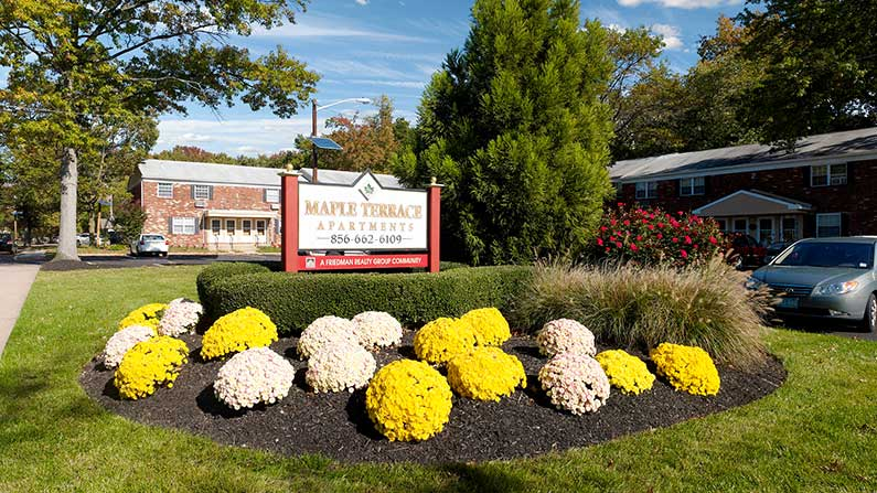 Entry sign and garden at Maple Terrace Apartments in Maple Shade, NJ.