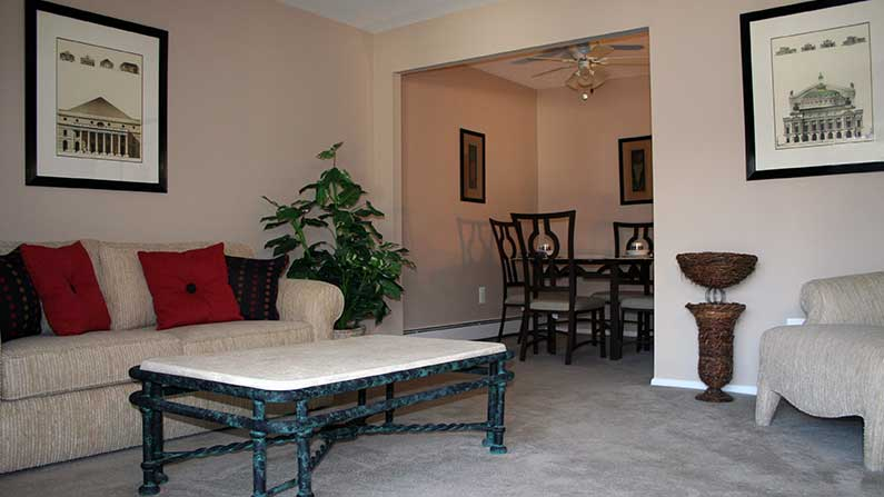 Furnished living room and dining room at Sea Aire Apartments in Somers Point.