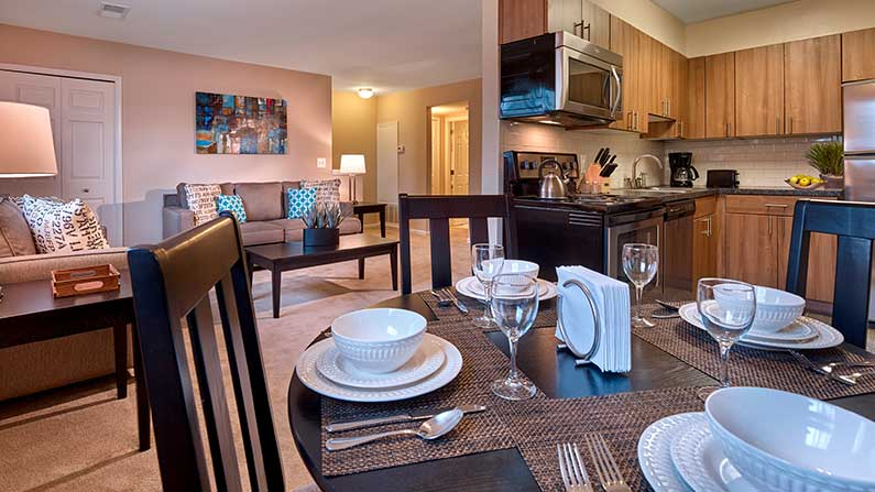 Kitchen, dining room, and living room at Village Square Harleysville, PA apartments.