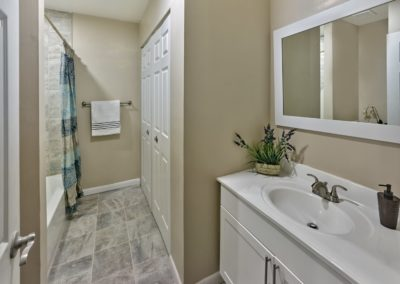 Newly renovated bathroom with large vanity and laundry closet