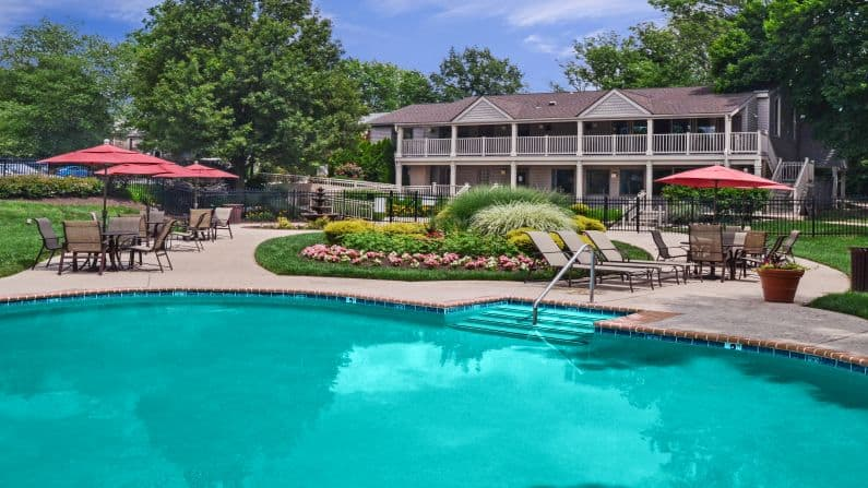 Willowyck Apartments pool with lounge chairs and patio tables at Upper Gwynedd apartments for rent.