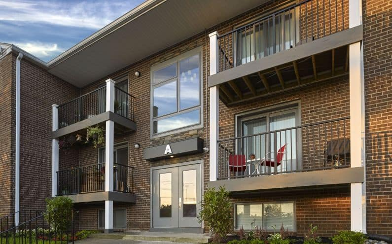 Brick building with private balconies at Phoenix View Apartments in Phoenixville, PA.