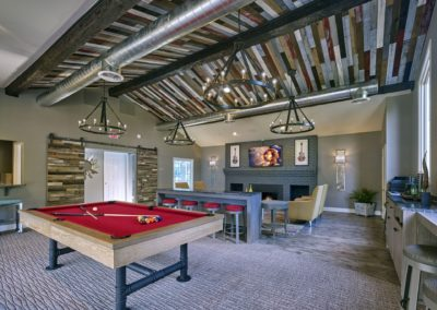 Willowyck Apartments clubhouse with pool table and large-screen TV