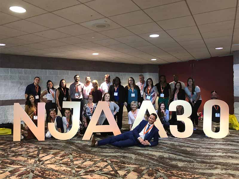 Friedman employees posing for a photo at the NJAA 2019 event