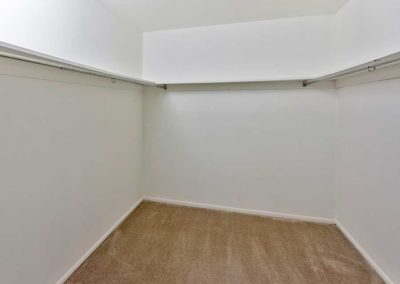 Carpeted walk-in closet with clothing racks and shelves at Maple Shade, NJ apartment for rent