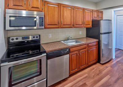 Chestnut House Apartments kitchen with stainless steel appliances