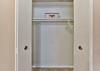 Large bedroom closet with shelf and clothes rod