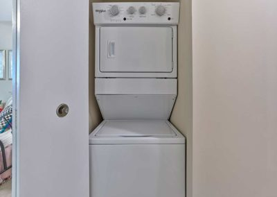 Sea Aire Apartments interior stacked washer and dryer