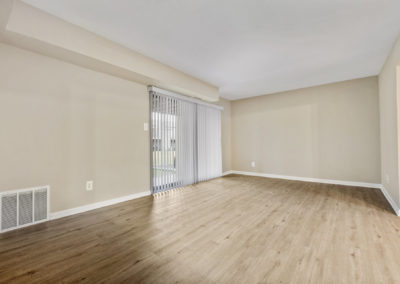 Gorgeous new hardwood flooring shown in large dining area with sliding doors out to patio