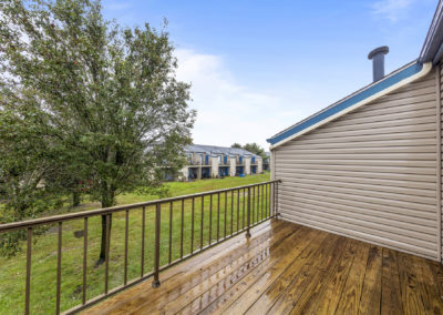 Balcony off of master bedroom in Somers Point, NJ townhome with plenty of space and view of well-kept grounds