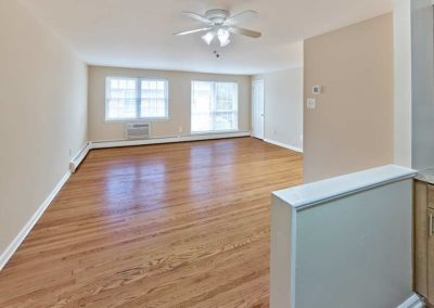 View of large living room from kitchen in apartment for rent in Prospect Park, PA