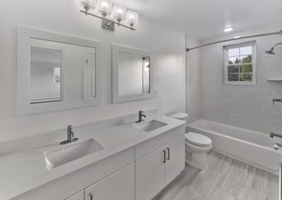 Double vanity with two sinks in renovated apartment bathroom in Wayne, PA
