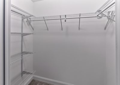 Walk-in closet with shelving and clothing racks