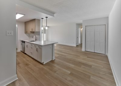 Spacious kitchen, living, and dining area completely renovated with new hardwood flooring