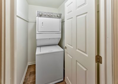 In-unit washer and dryer stacked inside of a laundry closet